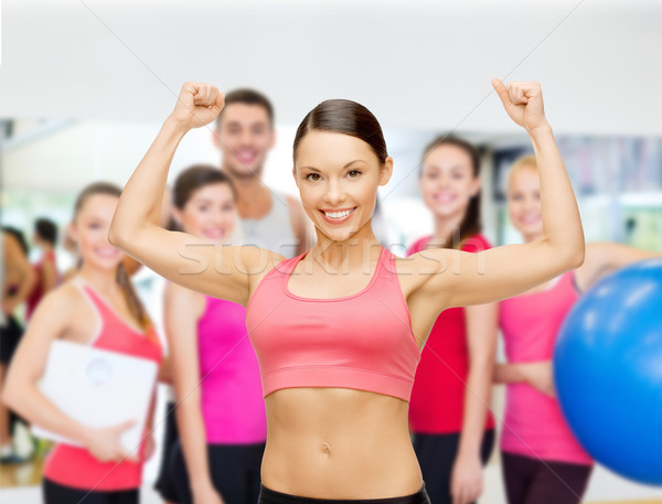 personal trainer with group in gym Stock photo © dolgachov