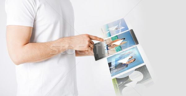 man with tablet pc watching video Stock photo © dolgachov