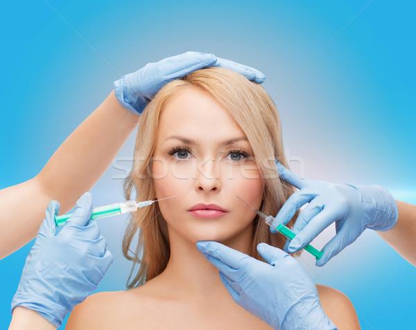 Cara da mulher mãos beleza cirurgia plástica mulher menina Foto stock © dolgachov
