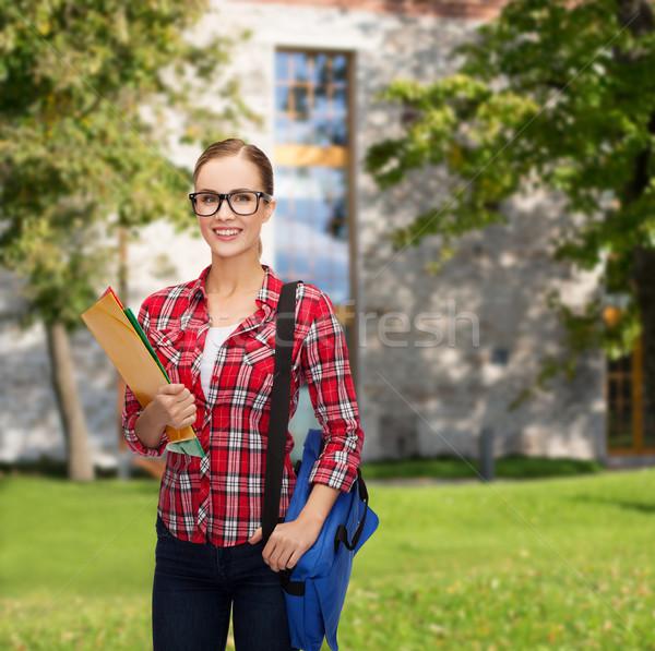 Stok fotoğraf: Kadın · öğrenci · gözlük · çanta · klasörler · eğitim