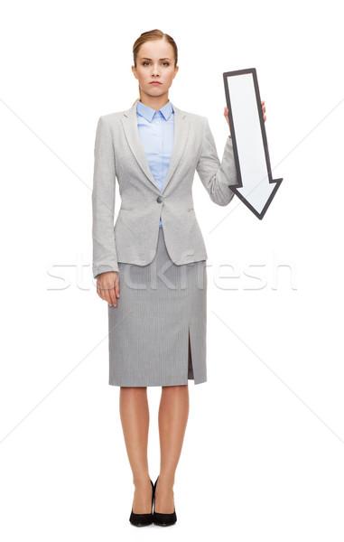 serious businesswoman with direction arrow sign Stock photo © dolgachov