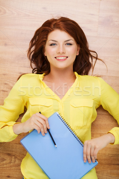 smiling female student with textbook and pencil Stock photo © dolgachov