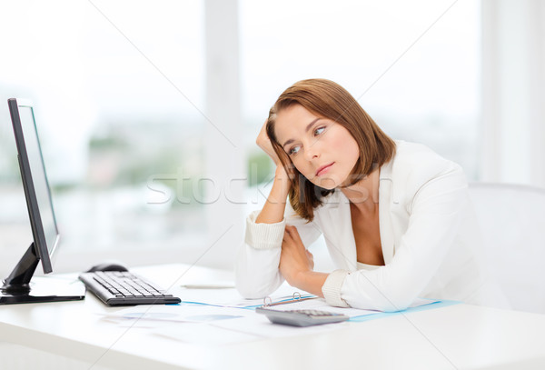 tired businesswoman with computer and papers Stock photo © dolgachov
