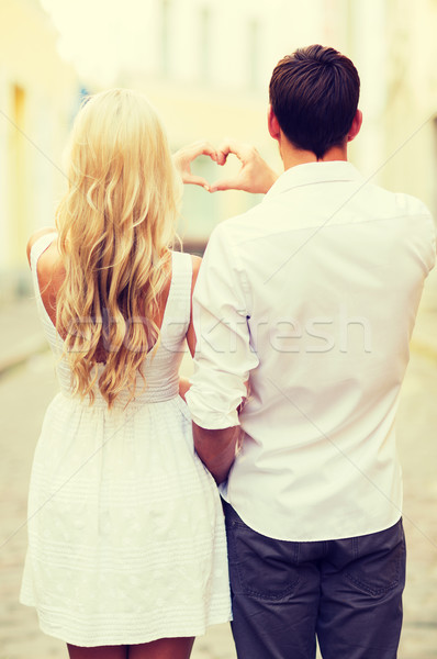 romantic couple in the city making heart shape Stock photo © dolgachov