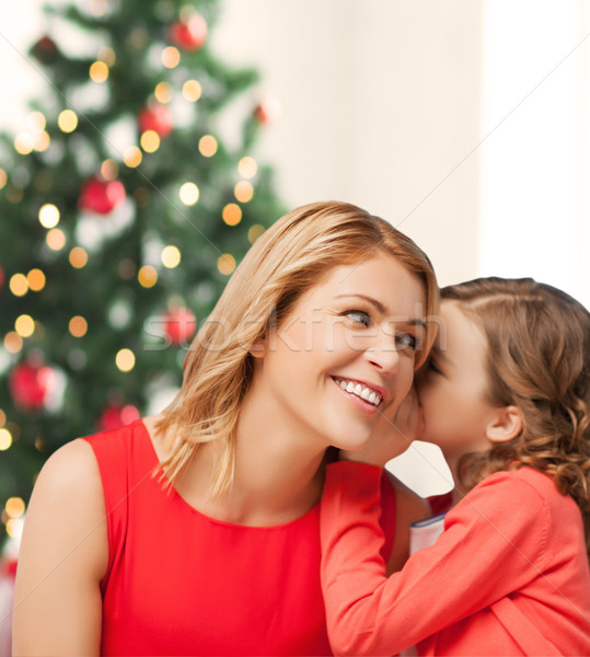 Mère fille chuchotement potins Noël noël Photo stock © dolgachov
