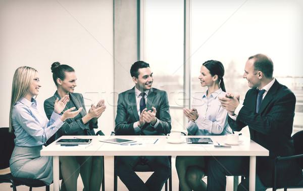 üzleti csapat laptop tapsol kezek üzlet technológia Stock fotó © dolgachov