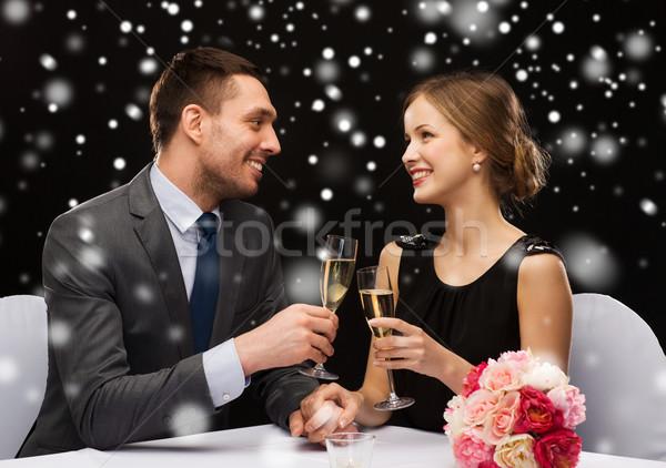 Souriant couple restaurant célébration Noël vacances Photo stock © dolgachov