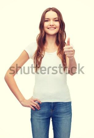 smiling teenager in blank white t-shirt Stock photo © dolgachov