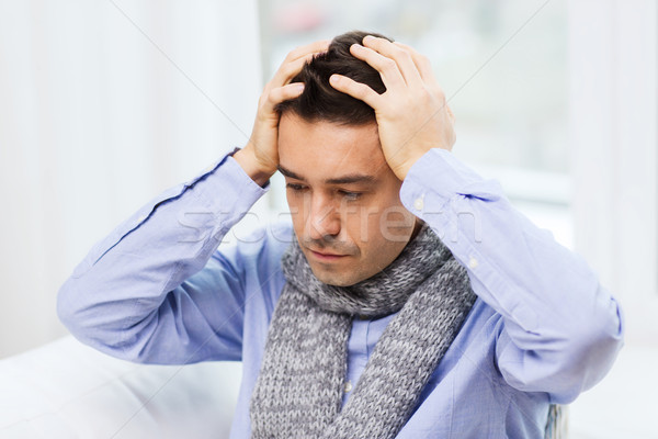 close up of ill man with flu and headache at home Stock photo © dolgachov