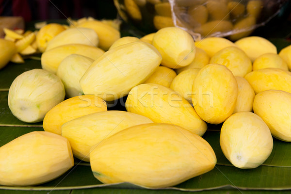 peeled mango at street market Stock photo © dolgachov