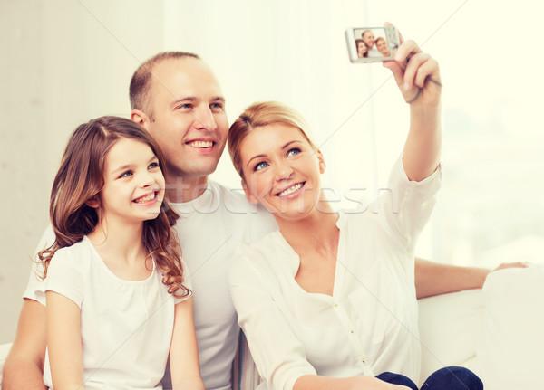 Famiglia felice bambina autoritratto famiglia bambino Foto d'archivio © dolgachov