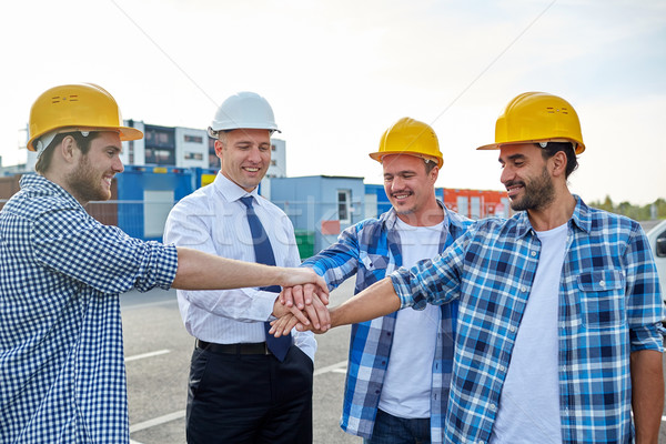builders and architects with hands on top Stock photo © dolgachov