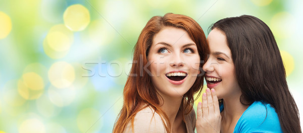 teenage girls or women whispering gossip Stock photo © dolgachov
