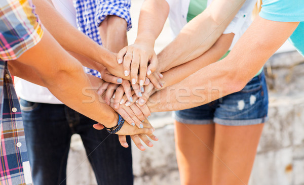 close up of friends hands on top Stock photo © dolgachov