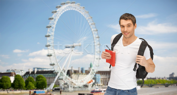 happy young man with backpack and book travelling Stock photo © dolgachov