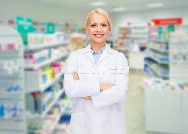 young woman pharmacist drugstore or pharmacy Stock photo © dolgachov