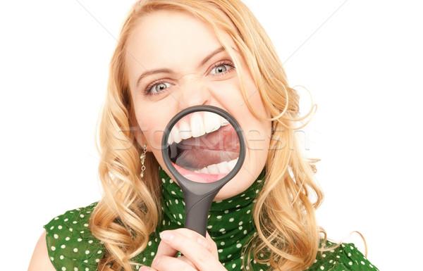 Kobieta lupą zęby zdjęcie szczęśliwy Zdjęcia stock © dolgachov