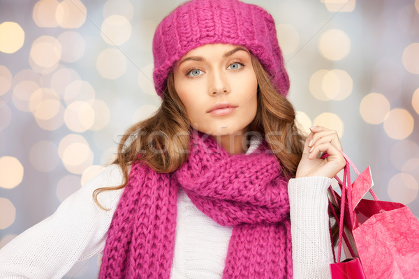young woman in winter clothes with shopping bags Stock photo © dolgachov