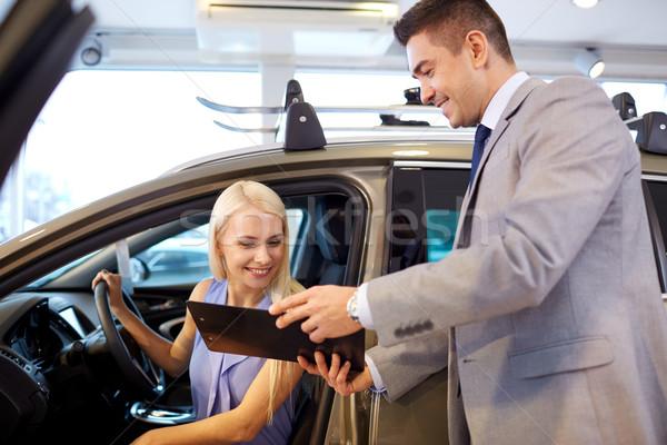 Feliz mujer auto mostrar salón Foto stock © dolgachov