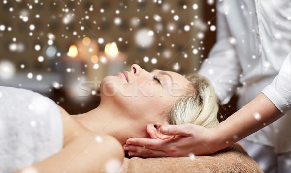 close up of woman having head massage in spa salon Stock photo © dolgachov