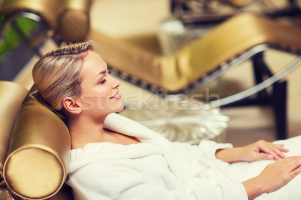 beautiful young woman sitting in bath robe at spa Stock photo © dolgachov