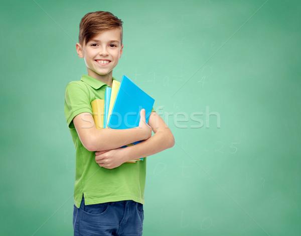 Feliz estudiante nino carpetas cuadernos infancia Foto stock © dolgachov