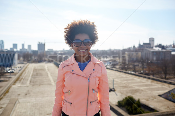 happy african american woman in shades on street Stock photo © dolgachov