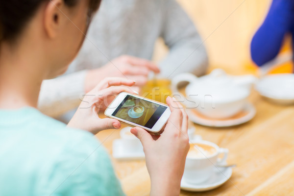 close up of woman smartphone picturing coffee cup Stock photo © dolgachov