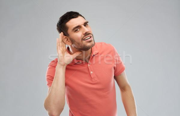 Férfi probléma hallgat valami kézmozdulat emberek Stock fotó © dolgachov