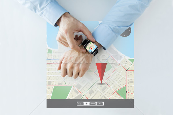 hands with gps navigator map on smart watch Stock photo © dolgachov