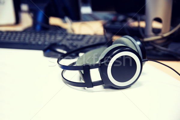 headphones at recording studio or radio station Stock photo © dolgachov