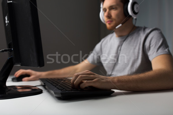 close up of man playing computer video game Stock photo © dolgachov