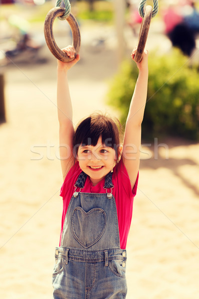 happy little girl on children playground Stock photo © dolgachov