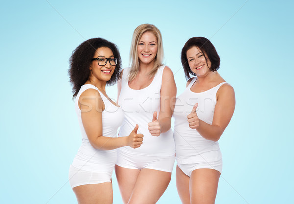 7e083a93f42  7429238 group of happy plus size women showing thumbs up by dolgachov Stock  photo