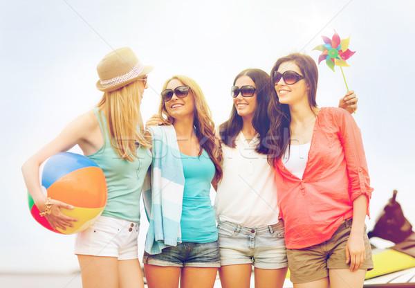 smiling girls in shades having fun on the beach Stock photo © dolgachov