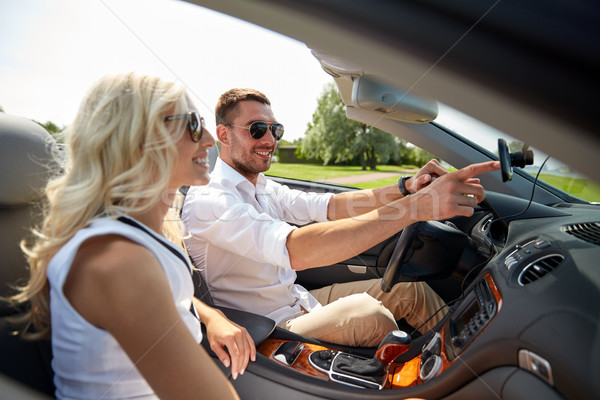 happy couple using gps navigation system in car Stock photo © dolgachov