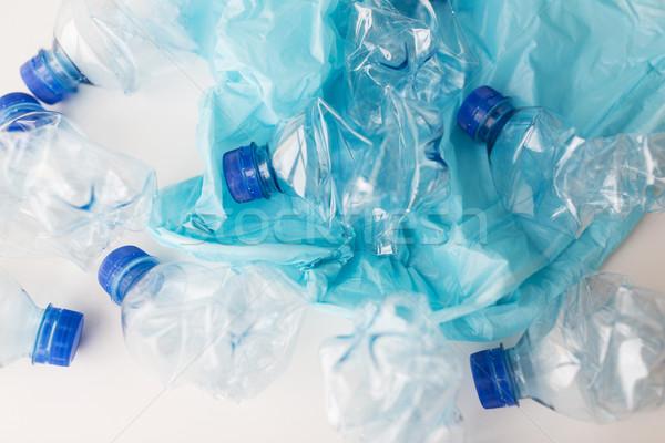 close up of used plastic bottles and rubbish bag Stock photo © dolgachov