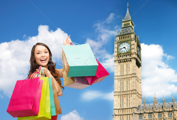 young happy woman with shopping bags over big ben Stock photo © dolgachov