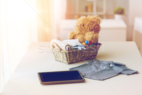 close up of baby clothes, toys and tablet pc Stock photo © dolgachov