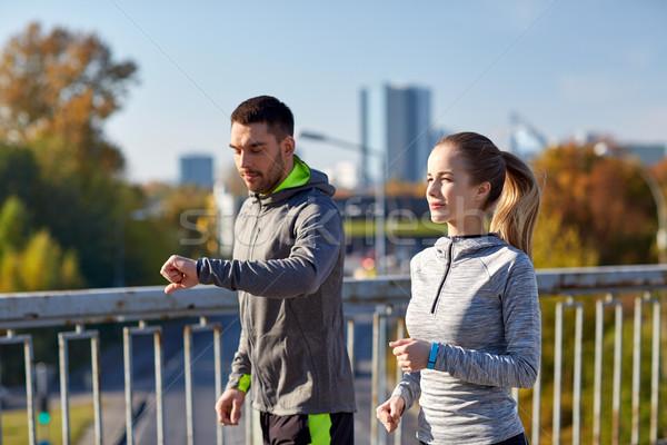 couple running over city highway bridge Stock photo © dolgachov