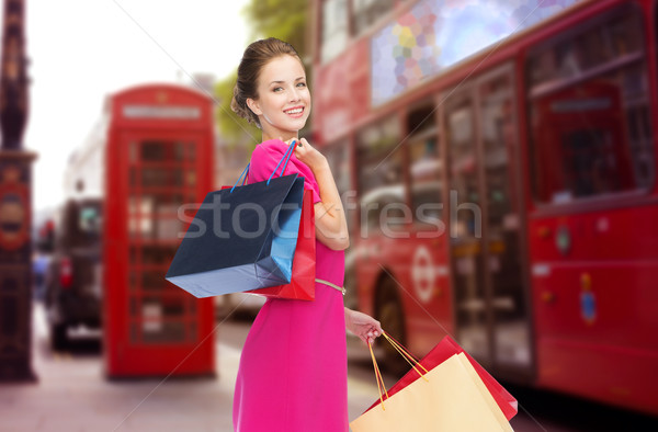 woman with shopping bags over london city street Stock photo © dolgachov