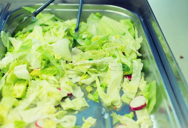 close up of romaine lettuce salad in container Stock photo © dolgachov