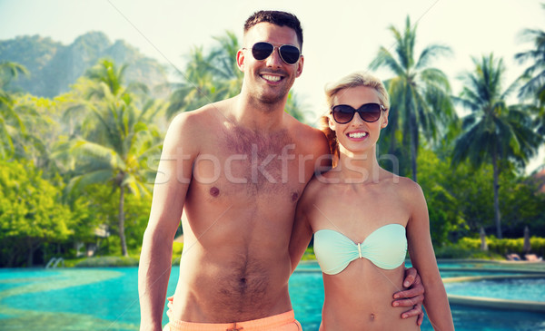 happy couple in swimwear hugging over hotel resort Stock photo © dolgachov