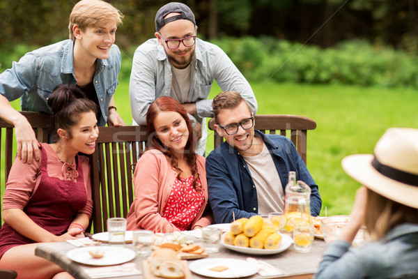 happy friends having dinner at summer garden party Stock photo © dolgachov