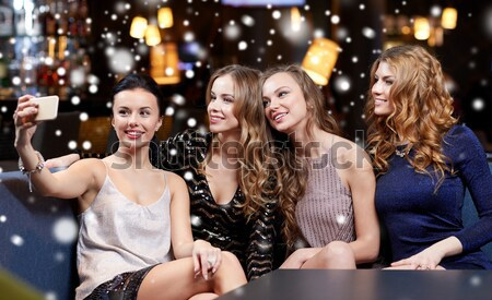 happy young women with sparklers over snow Stock photo © dolgachov