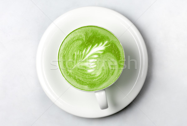 cup of matcha green tea latte over white Stock photo © dolgachov