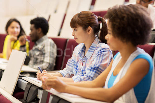 group of students talking in lecture hall Stock photo © dolgachov