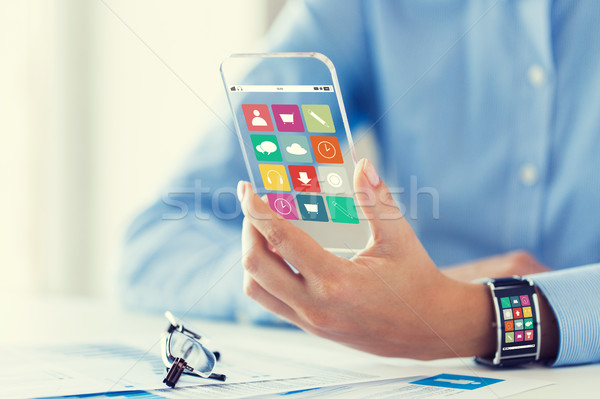 hand with app icons on smart phone and watch Stock photo © dolgachov