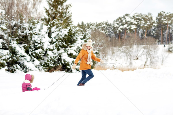 happy father pulling sled with child in winter Stock photo © dolgachov