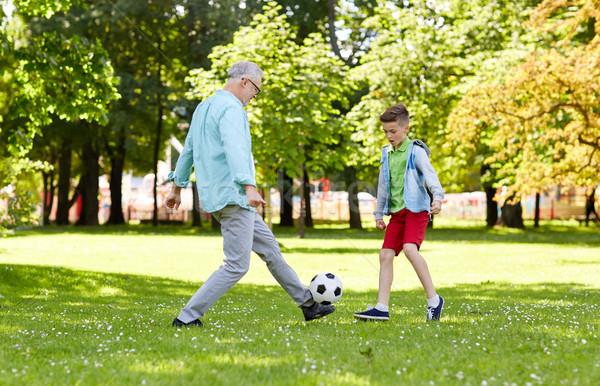 Idős férfi fiú játszik futball nyár park Stock fotó © dolgachov